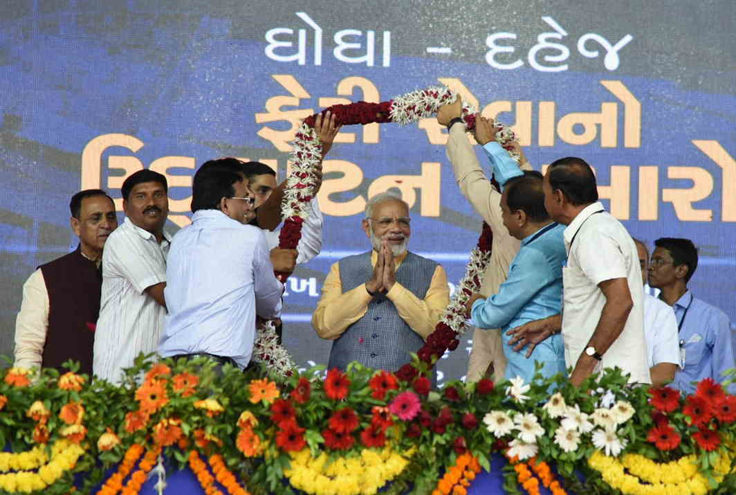 Modi seeks votes in Bhavnagar. Are Gujarat polls the reason why the Winter Session has not been called? Photo: UNI