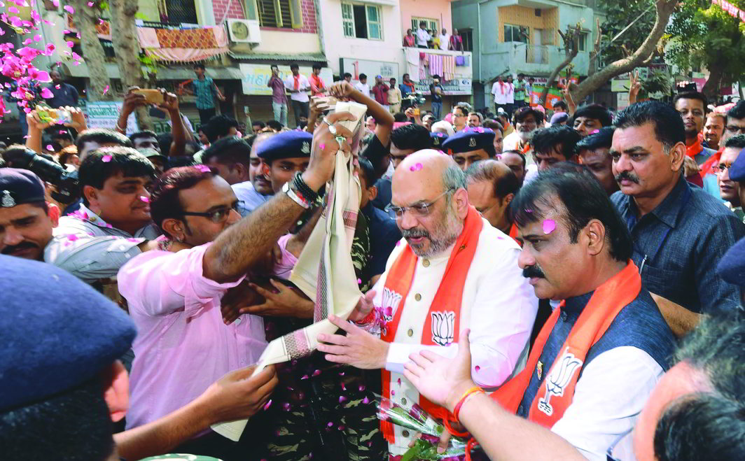 BJP national president Amit Shah on a campaign trail in Ahmedabad. Photo: UNI