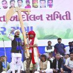 Hardik Patel (in red turban) at a Patidar rally in Gujarat. Photo: UNI
