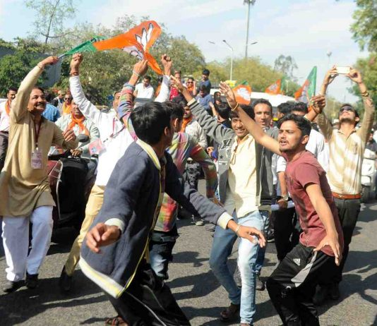 Gujarat BJP workers celebrating paty's victory in assembly polls in Ahmedabad on December 18. Photo: UNI