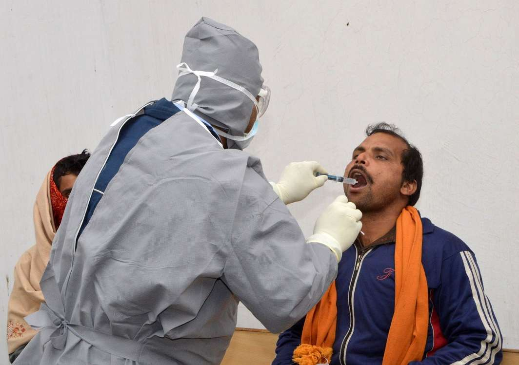 A doctor examines a patient for swine flu at Patna Medical College and Hospital. Photo: UNI