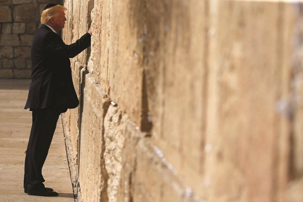 President Trump spends a quiet moment at the Wailing Wall, Jerusalem, in May. Photo: UNI