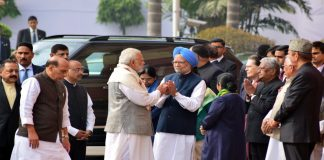 After bitter spat, Narendra Modi greets Manmohan Singh at Parliament