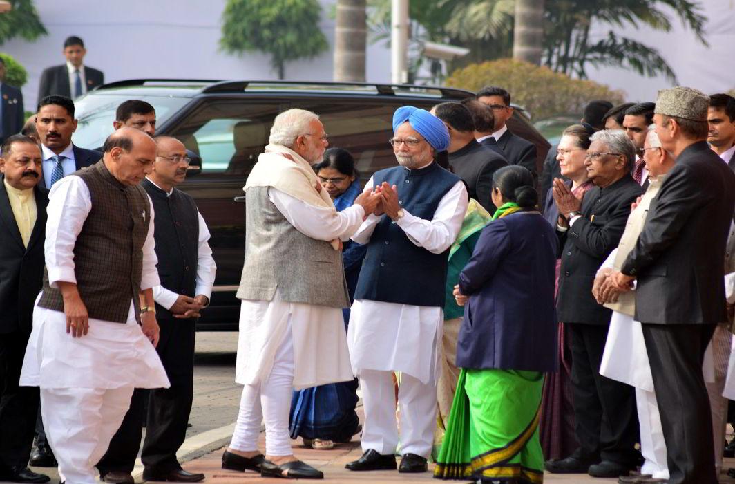 After bitter spat, Narendra Modi greets Manmohan Singh at Parliament