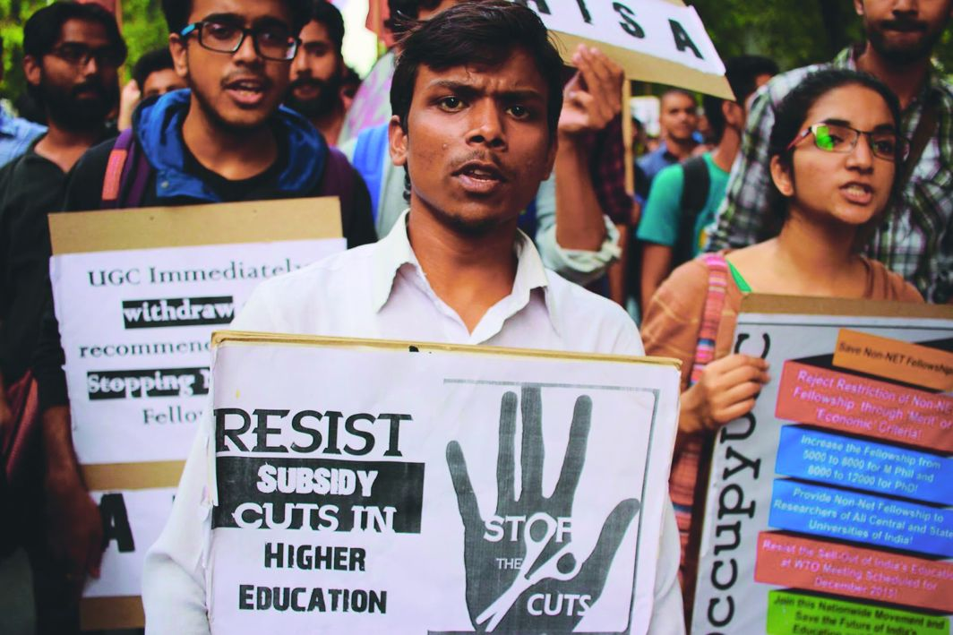 Students protesting against withdrawal of fellowships and scholarships by the UGC