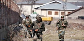 Indian Army jawans taking position near the site of a gunbattle with militants in Jammu and Kashmir