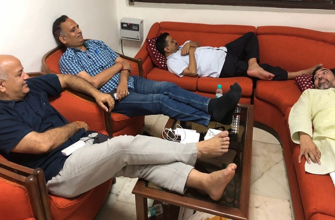 Arvind Kejriwal (centre) with his ministers Manish Sisodia (left), Satyendar Jain and Gopal Rai at the Lt Governor's residence/Photo courtesy: twitter