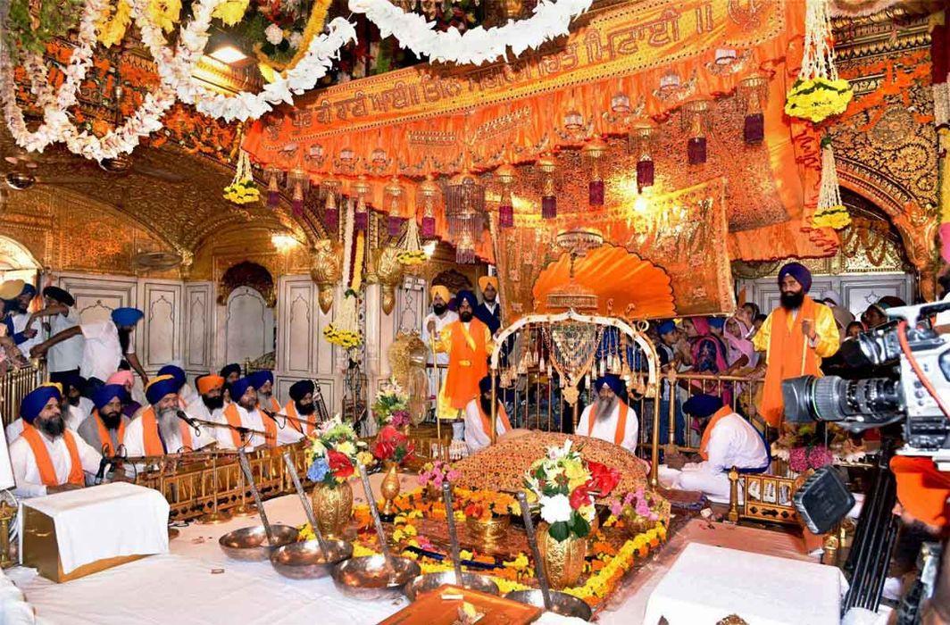 Granthis with the Shri Guru Granth Sahib in the inner sanctum sanctorum of the Golden Temple in Amritsar