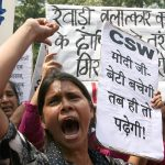 Members of women's rights organisations protest over the Rewari gangrape in New Delhi/Photo: UNI