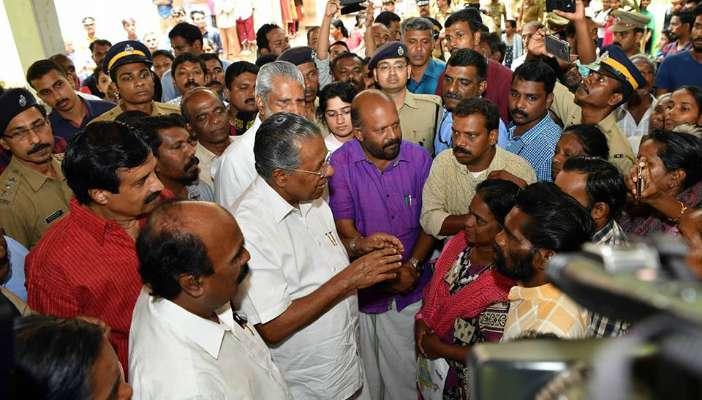 Chief Minister Pinarayi Vijayan talks to flood victims at a relief camp near Chengannur in Kerala/Photo Courtesy: Big News Live