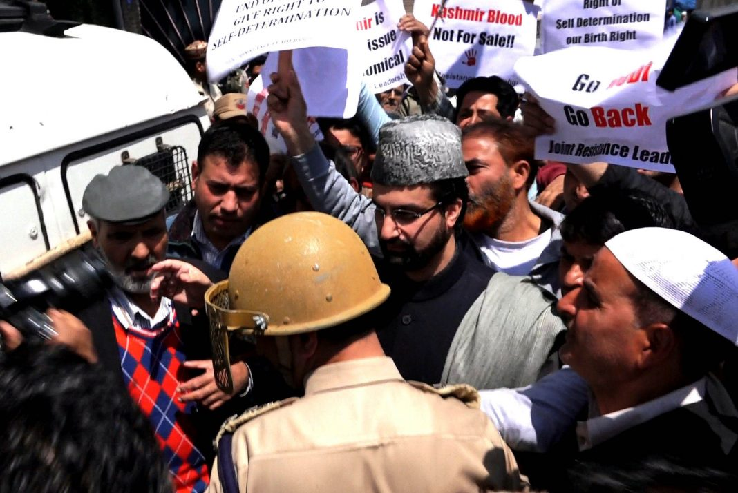 Awami Action Committee chairman Mirwaiz Umar Farooq being taken into preventive custody for defying house arrest in Srinagar/Photo: UNI