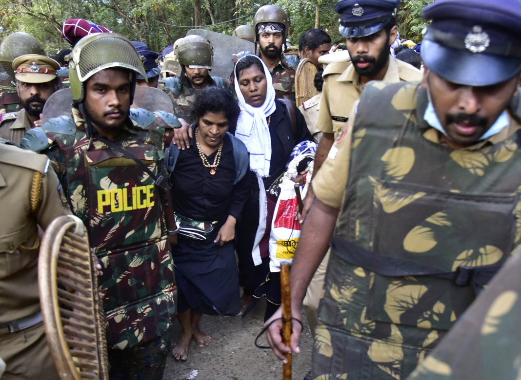 Kanaka Durga (left) and Bindu Ammini being escorted by police/Photo: UNI