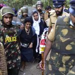 Kanaka Durga (left) and Bindu Ammini being escorted by police/Photo: UNI