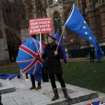 An anti-Brexit protester demonstrates outside the Houses of Parliament in London/Photo: UNI