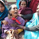 A victim of the Muzaffarnagar riots breaks down while others console her/Photo: UNI