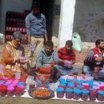 Prisoners making organic pickles at the district jail in Udhampur, Jammu. Although they can work and earn money legally they can't vote/Photo: UNI