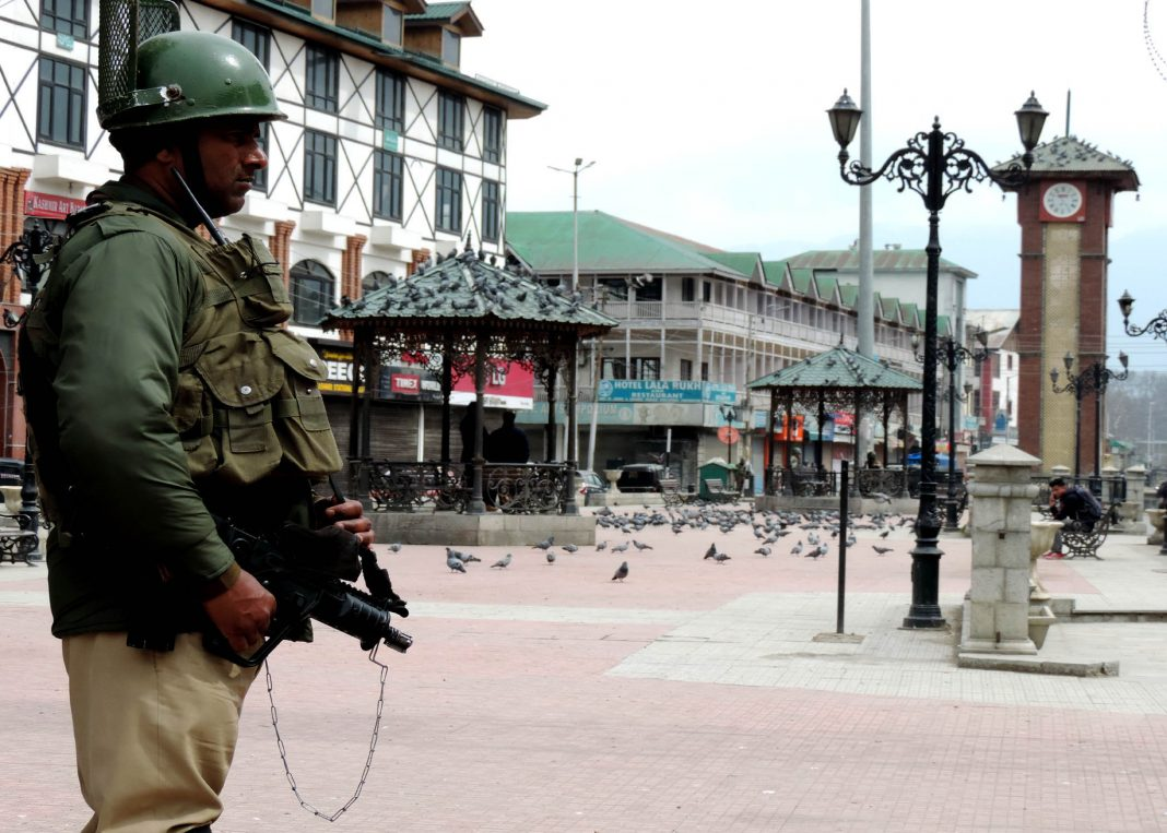 An armyman keeping vigil at Lal Chowk, Srinagar, during a strike called against the ban of JKLF/Photo: UNI