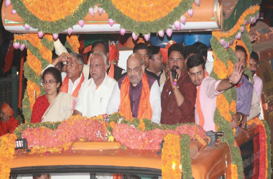BJP chief Amit Shah and former Karnataka CM BS Yeddyurappa (third from left) at a poll rally of Tejasvi Surya (waving)/Photo: UNI