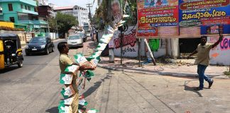 Election officials removing campaign material of various political parties in Thiruvananthapuram/Photo: UNI