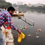 Materials used in religious rituals being dumped into the Gomti post-Diwali/Photo: UNI