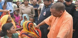 UP CM Yogi Adityanath meets the victims' families in Sonbhadra/Photo: UNI