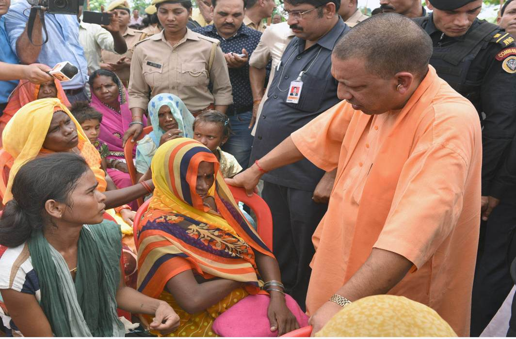 UP CM Yogi Adityanath meets the victims' families in Sonbhadra/Photo: UNI