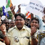 Members of the Dalit community protesting against the Supreme Court's order diluting the SC/ST Act last year/Photo: UNI