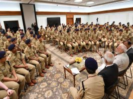 PM Modi interacting with IPS probationers in New Delhi/Photo: PIB