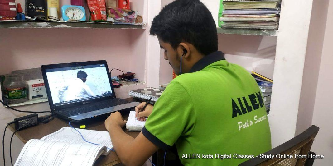 student attending an online class through a computer