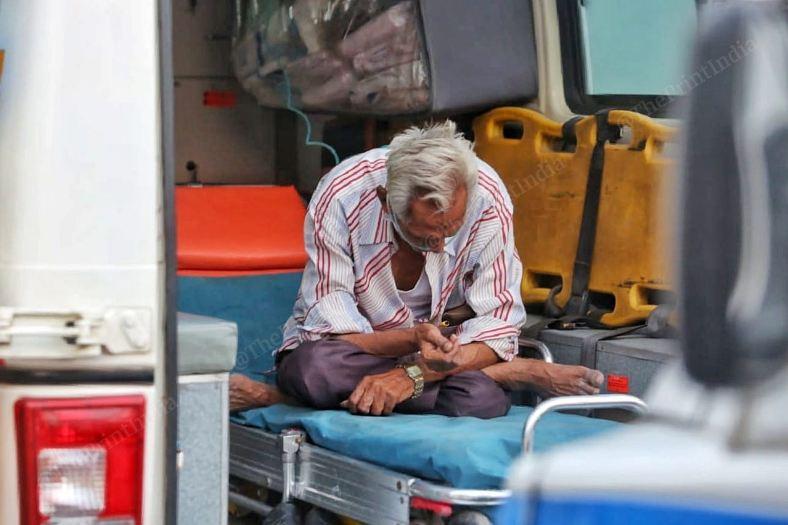 covid-19 victim waits outside the hospital in an ambulance