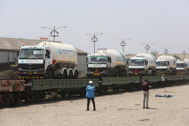 Empty tanker trucks get loaded at Kalamboli on Monday on train and will return in four days.