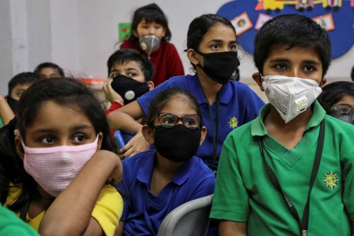 kids in kolkata in the classroom with mask.