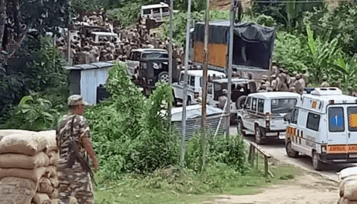 Fully-armed-Assam-Police-entering-Mizoram-after-breaching-the-buffer-post-held-by-CRPF-min
