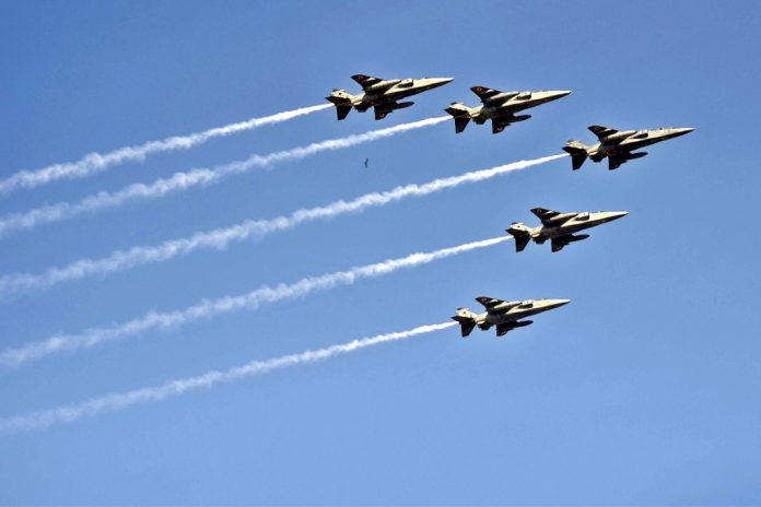 Flight of glory - Indian Air Force fighter jets display a fly-by during the rehearsal for the Republic Day parade over Rajpath in New Delhi on Friday.UNI PHOTO-11u