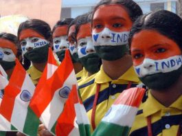 GOING BY FACE VALUE: Students paint their faces in national colours on the occasion of Republic Day at Everwin School, in Chennai, UNI