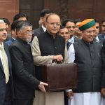 Union Finance Minister Arun Jaitley with Minister of State, Arjun Ram Meghwal and Santosh Gangwar coming out of North Block office on way to Parliament house to present the General Budget for the year 2017-18 in New Delhi. Photo: UNI