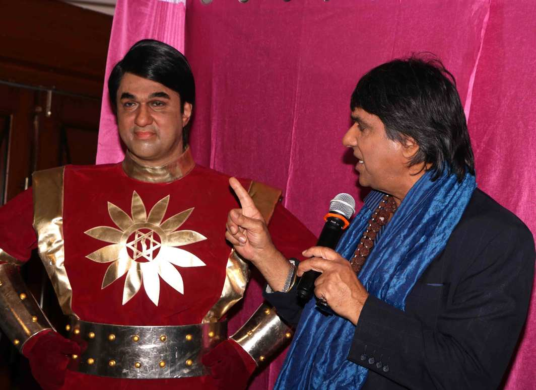 FEEL THE FORCE: Television actor Mukesh Khanna unveils a wax statue of Shaktiman in Mumbai, UNI