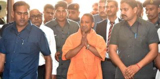 FIRST DAY AT WORK: Uttar Pradesh Chief Minister Yogi Adityanath arrives for a meeting with police officers in Lucknow, UNI