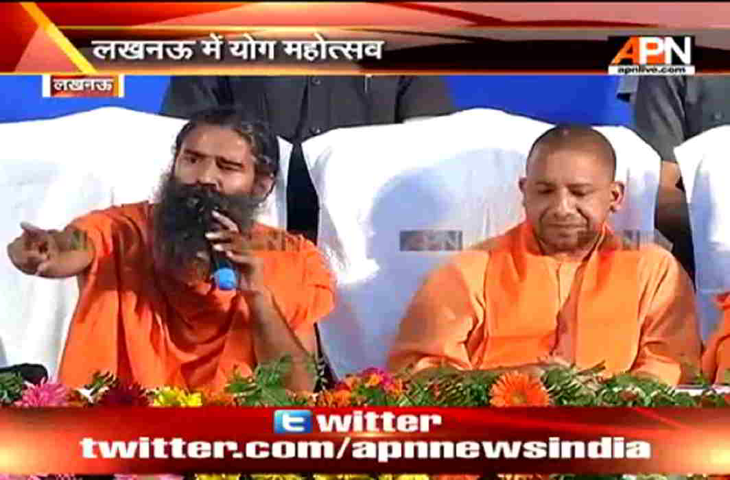 Baba Ramdev addressing press along UP CM Yogi Adityanath