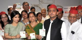 PICKING UP THE PIECES: Samajwadi Party president Akhilesh Yadav, with wife and party MP Dimple Yadav, distributes party membership slips at the SP office in Lucknow, UNI