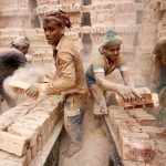 Brick factory workers load carts with bricks to take them into warehouse in Dhaka, Reuters/UNI