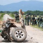HORROR ON THE ROAD: Thai armymen search the area of a roadside bomb blast in the southern province of Pattani, Thailand, which claimed the lives of six soldiers, Reuters/UNI