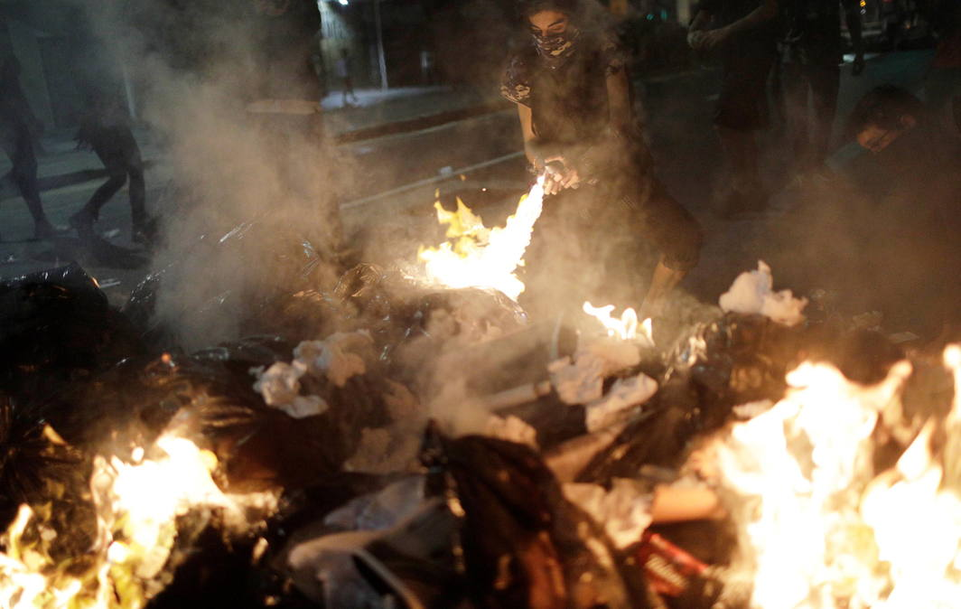 BURN BABY BURN: A demonstrator burns a barricade during a protest against President Michel Temer's proposal reform of Brazil's social security system in a general strike in Rio de Janeiro, Reuters/UNI