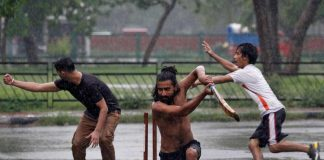 HOW BEAUTIFUL IS THE RAIN: Boys play cricket at a parking lot as it rains in Chandigarh, Reuters/UNI