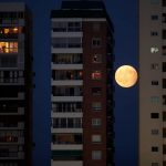 RISING OF THE MOON: A partial lunar eclipse as viewed from between buildings in Malaga, southern Spain, Reuters/UNI