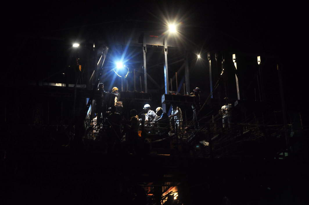 ALL NIGHT LONG: Men at work during the construction of the first flyover in Agartala, UNI