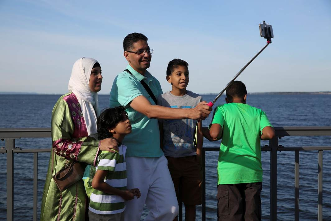 FAMILY MOMENTS: A Muslim family uses a selfie stick to take photos after Eid al-Adha prayers in Bensonhurst Park in Brooklyn, New York, Reuters/UNI