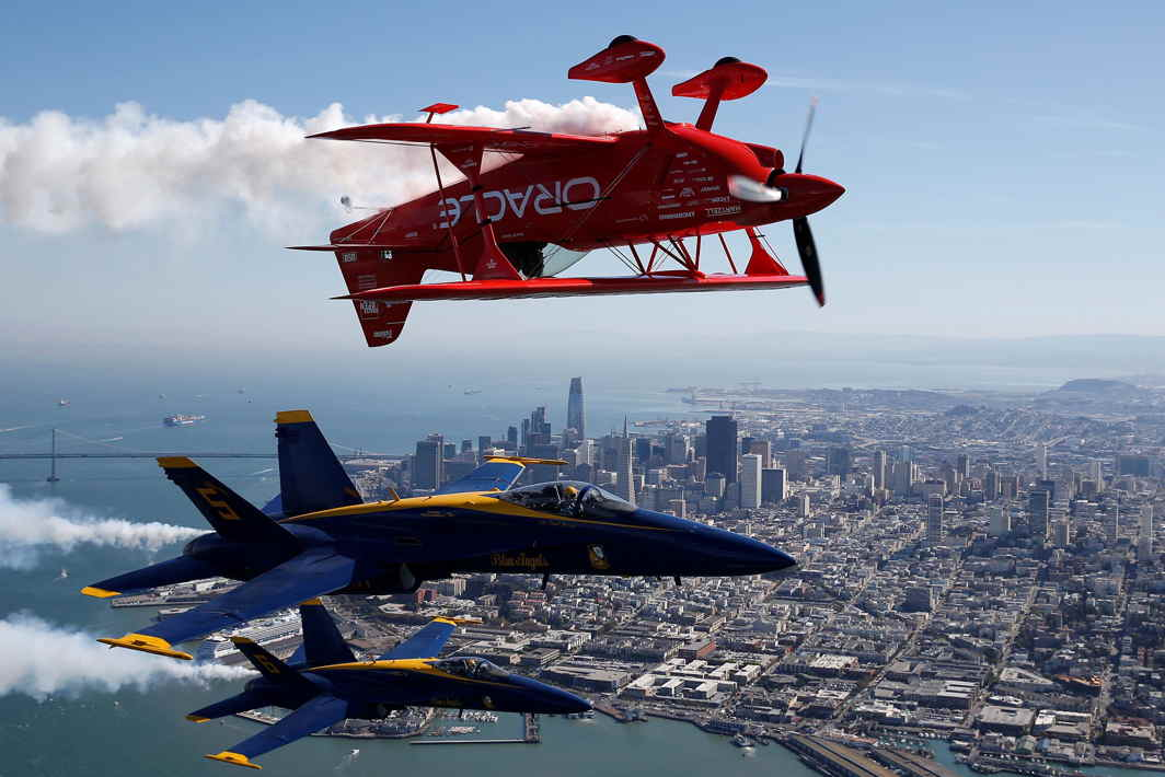 NOTHING BY CHANCE: The US Navy Blue Angels flight demonstration squadron and Team Oracle aerobatics pilot, Sean Tucker, fly over San Francisco Bay during a photo flight ahead of Fleet Week in San Francisco, California, US, Reuters/UNI