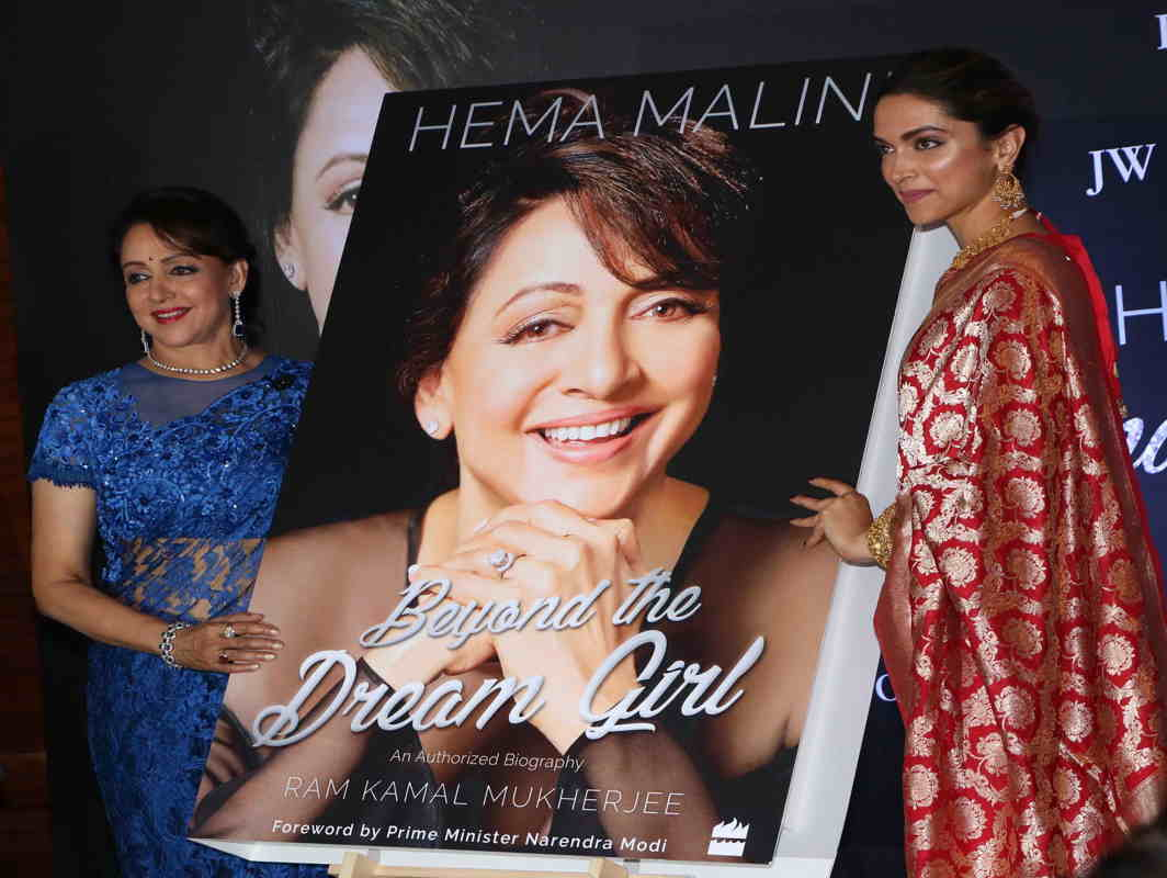 "AN ENIGMA: Bollywood actress Deepika Padukone, with Hema Malini, launches the official biography of the legendary actress Hema Malini ""Beyond the Dream Girl"" in Mumbai, UNI"