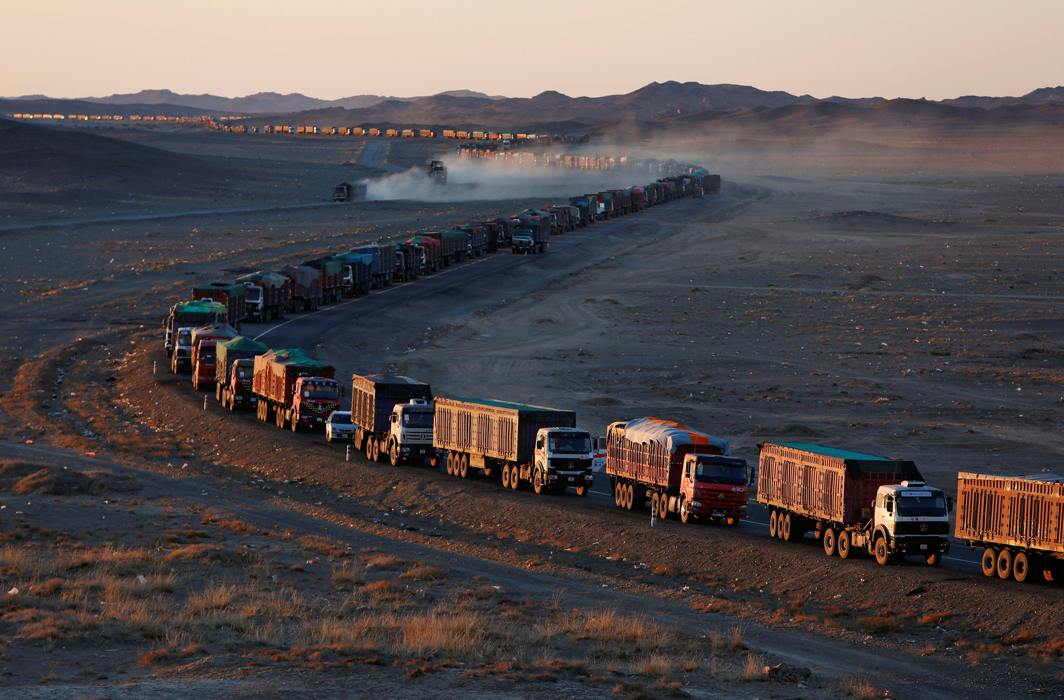 LONG HAUL: Thousands of trucks loaded with coal are lined up for up to 130 kilometres from the Mongolia-China border on a sole road in the Gobi desert, Mongolia; the journey can take more than a week, Reuters/UNI